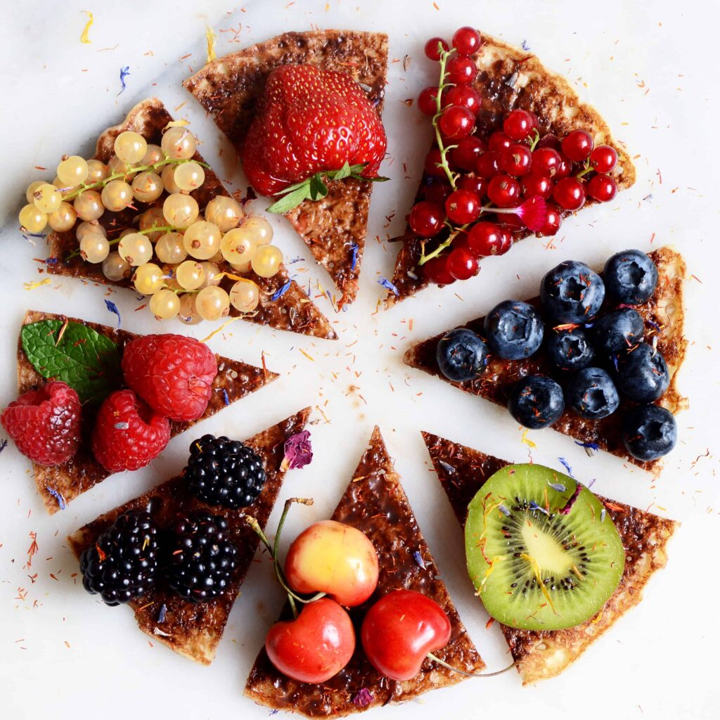 Protein Banana Pancake Pizza with fruit, cut into slices