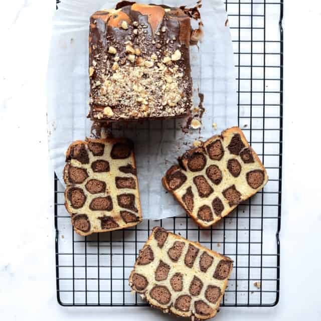 Chocolate Leopard Brioche Cake slices on a cooling rack