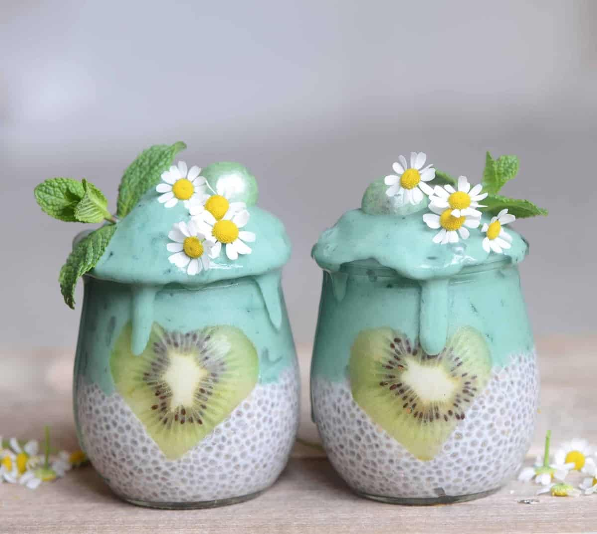 Vegan chia jars with  mint spirulina smoothie topped with edible flowers