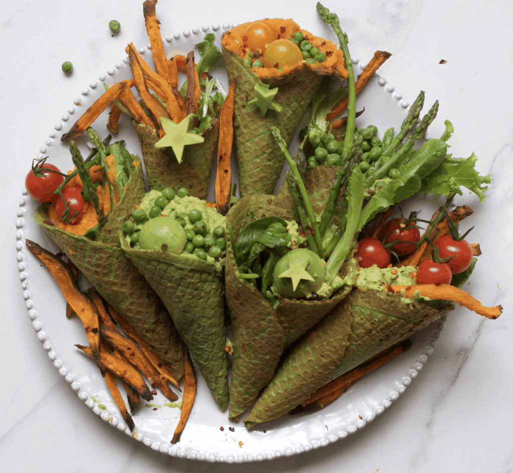 Savory kale waffle cones filled with vegetables arranged on a plate