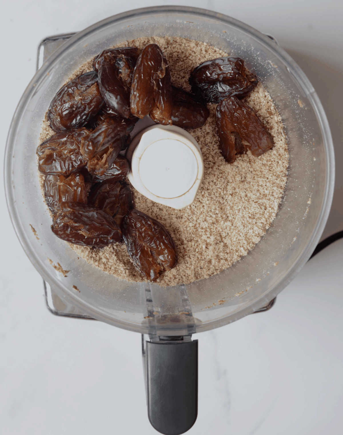 Blending nuts and dates in a blender