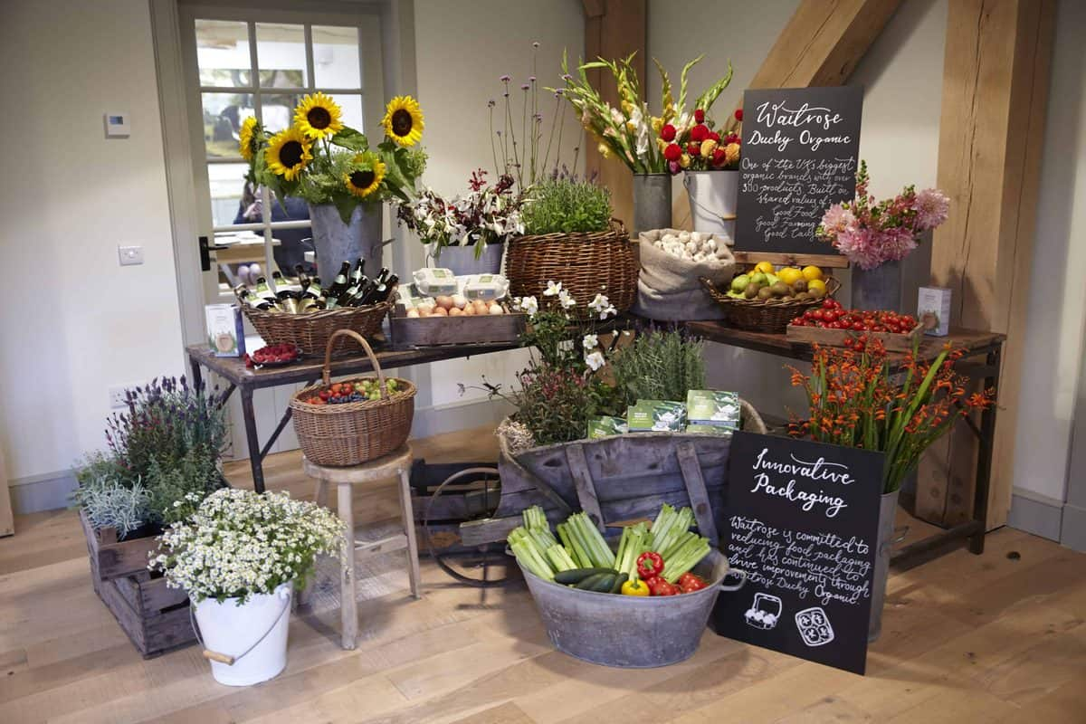 A welcome corner with flowers and produce for the 25 year celebration of Duchy Organic