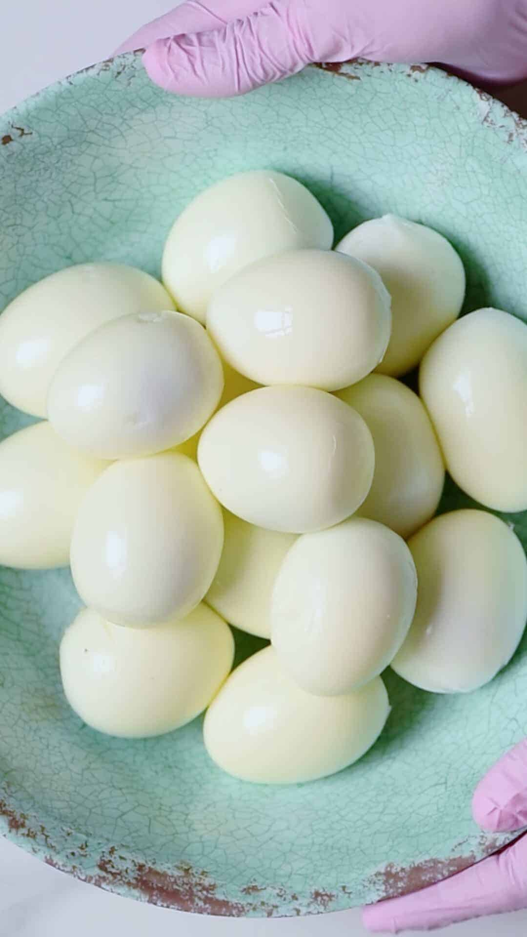 16 peeled boiled eggs in a bowl