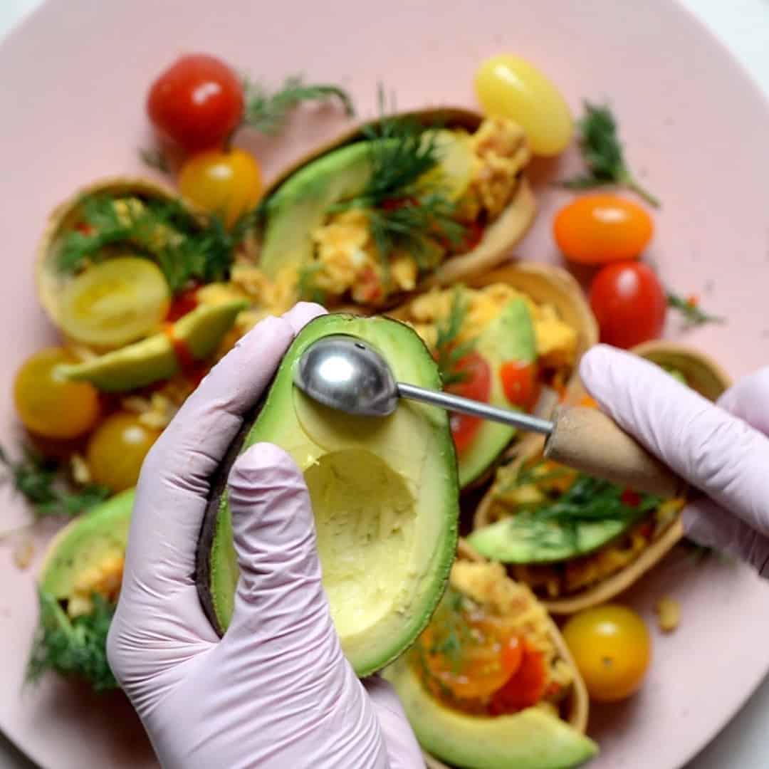 Making avocado balls with melon baller