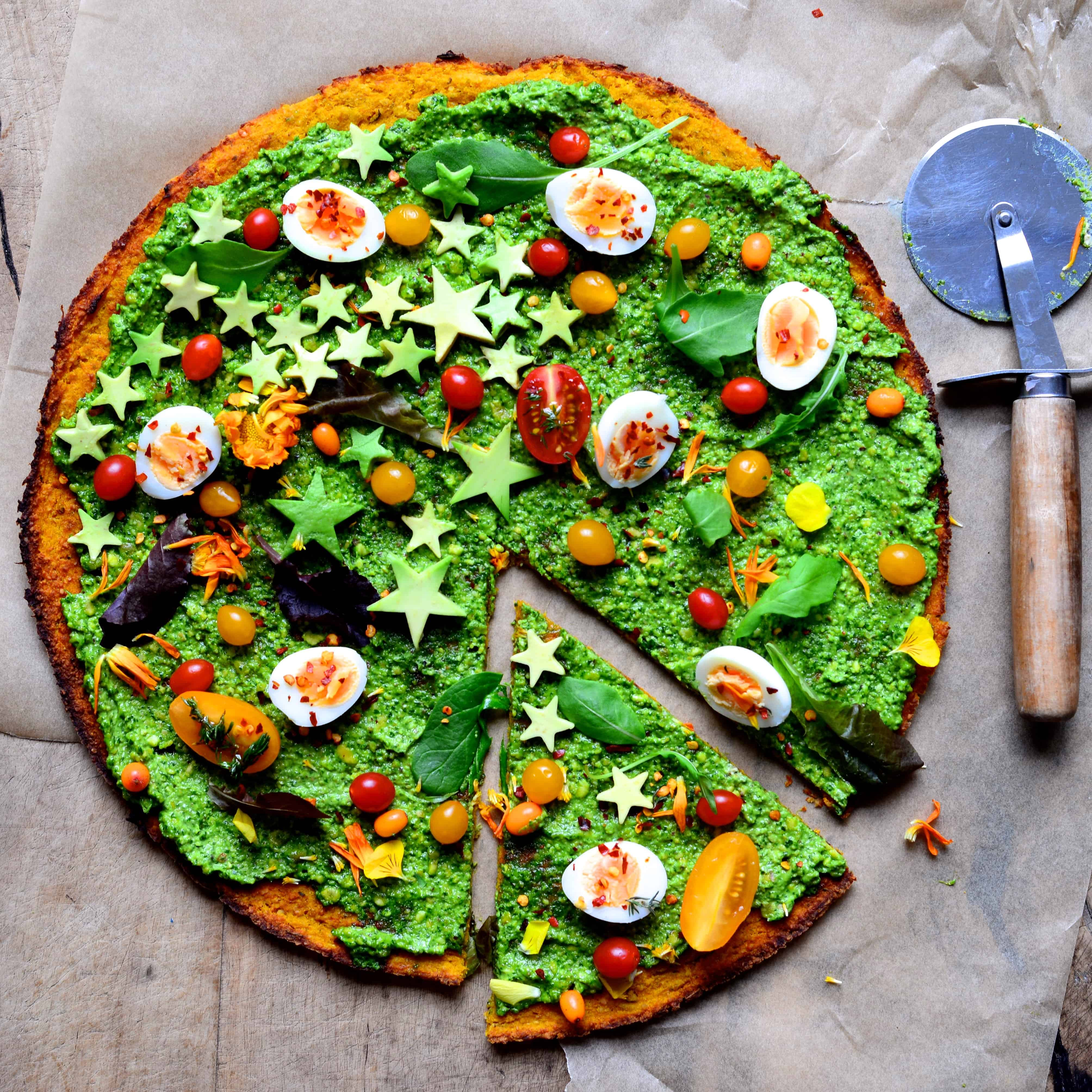 butternut squash and pesto pizza with veggies and quails eggs.
