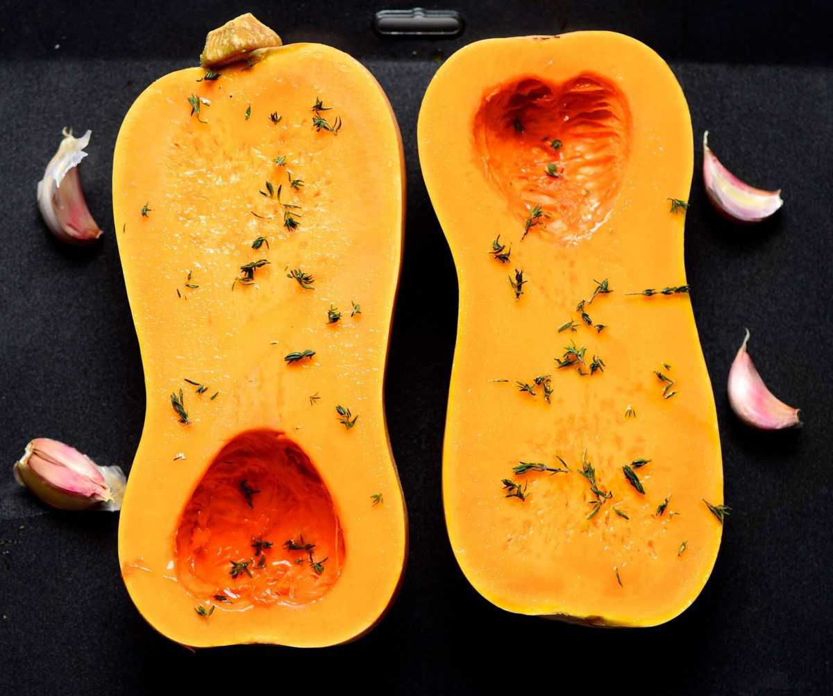 Butternut Squash halves on a baking tay