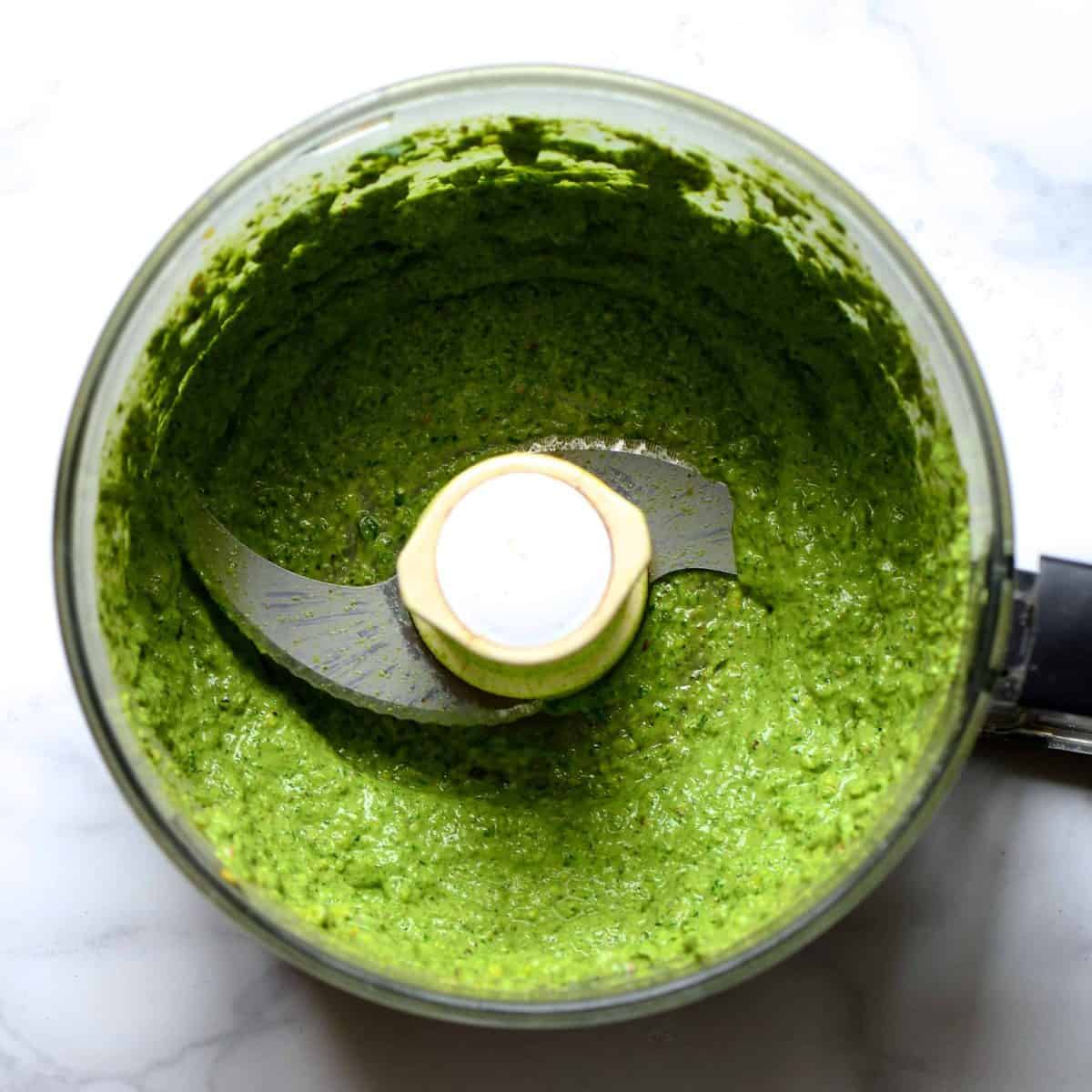 Green sauce in a blender
