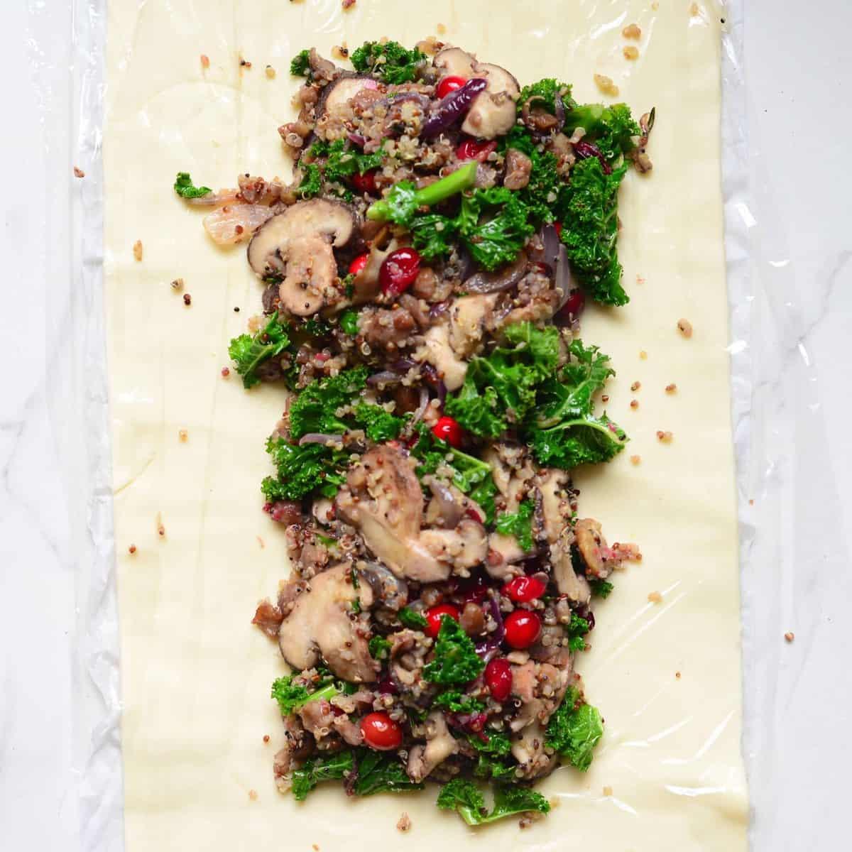 A decorated vegetarian christmas mushroom wellington with a vegan christmas recipe option.