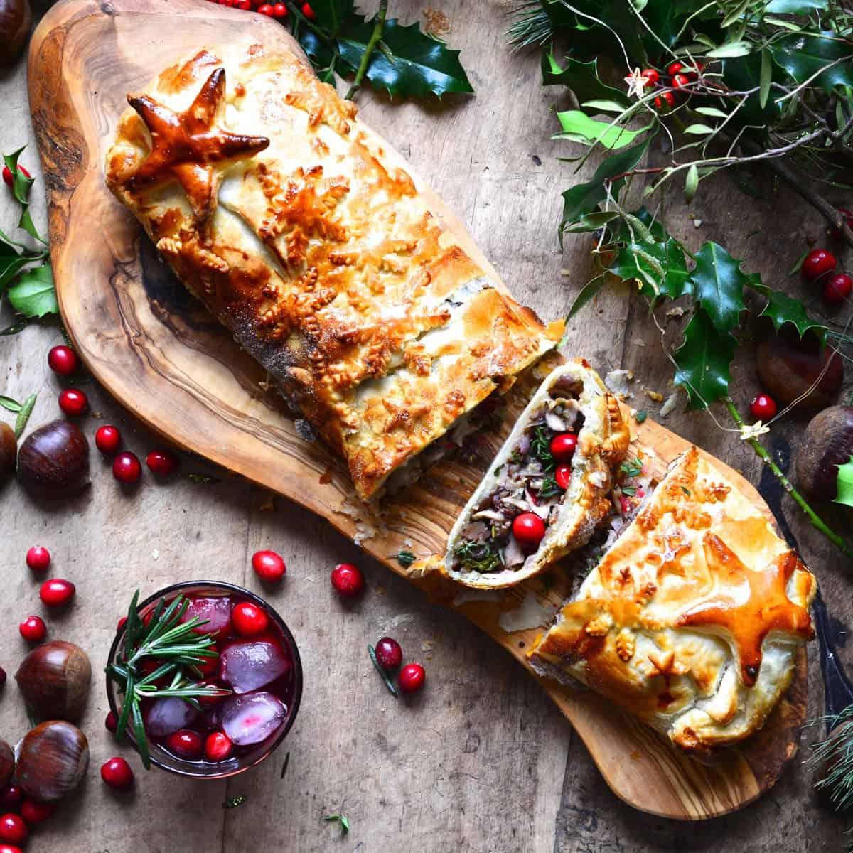 Vegan christmas mushroom wellington recipe , perfect for a vegan christmas dinner - with a mushroom, chestnut, cranberry, kale and quinoa filling.