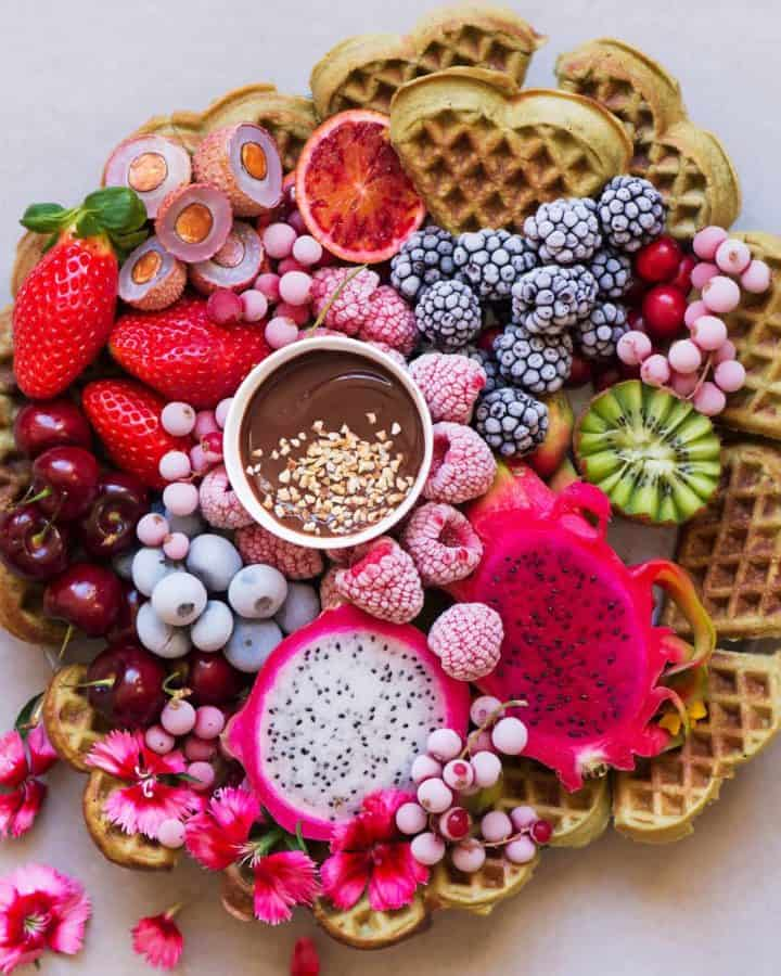 Matcha protein waffles served with berries and homemade nutella