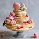 buteermilk pancake cake with roses, jam, coconut cream frosting, macaron