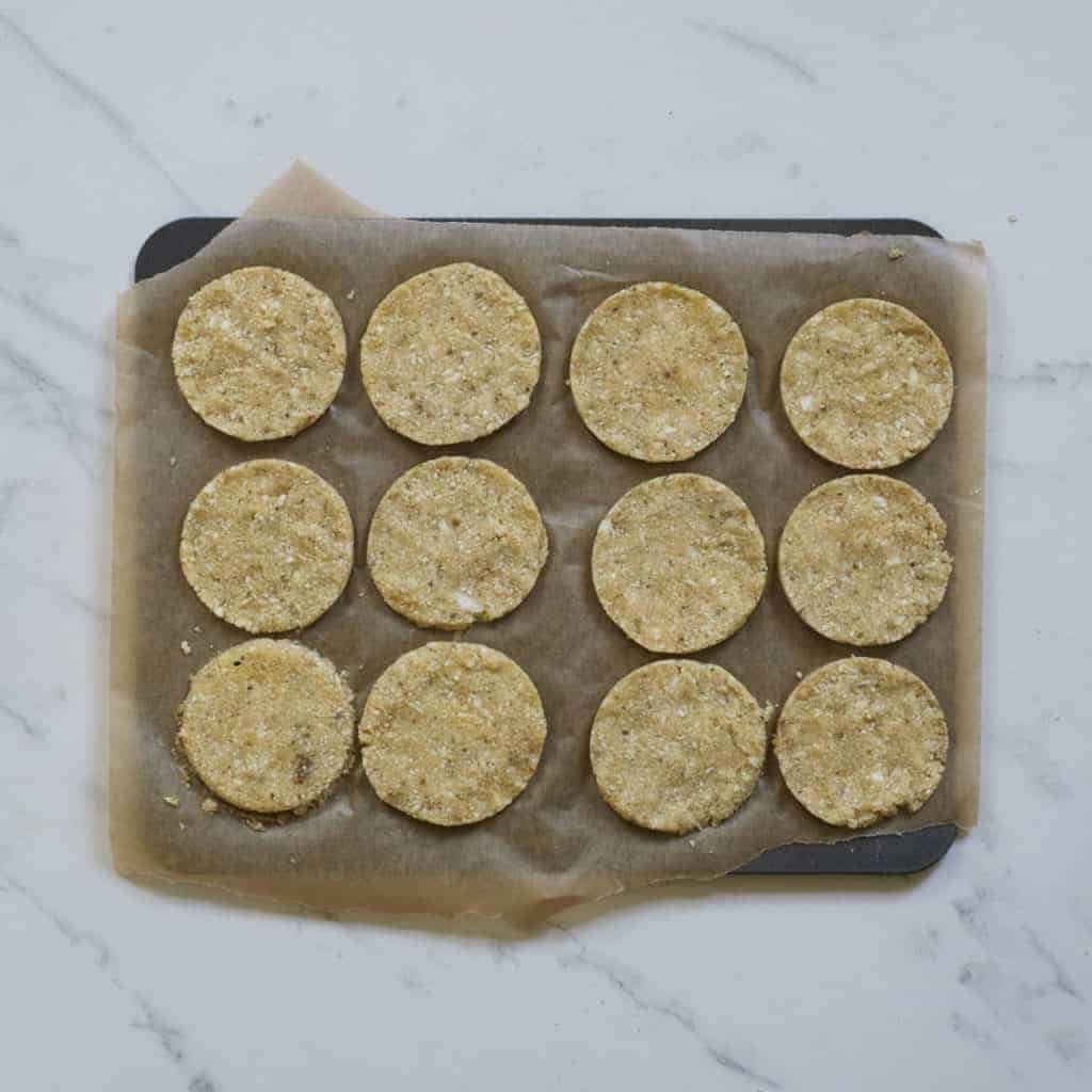 Mini pizza crusts on a tray