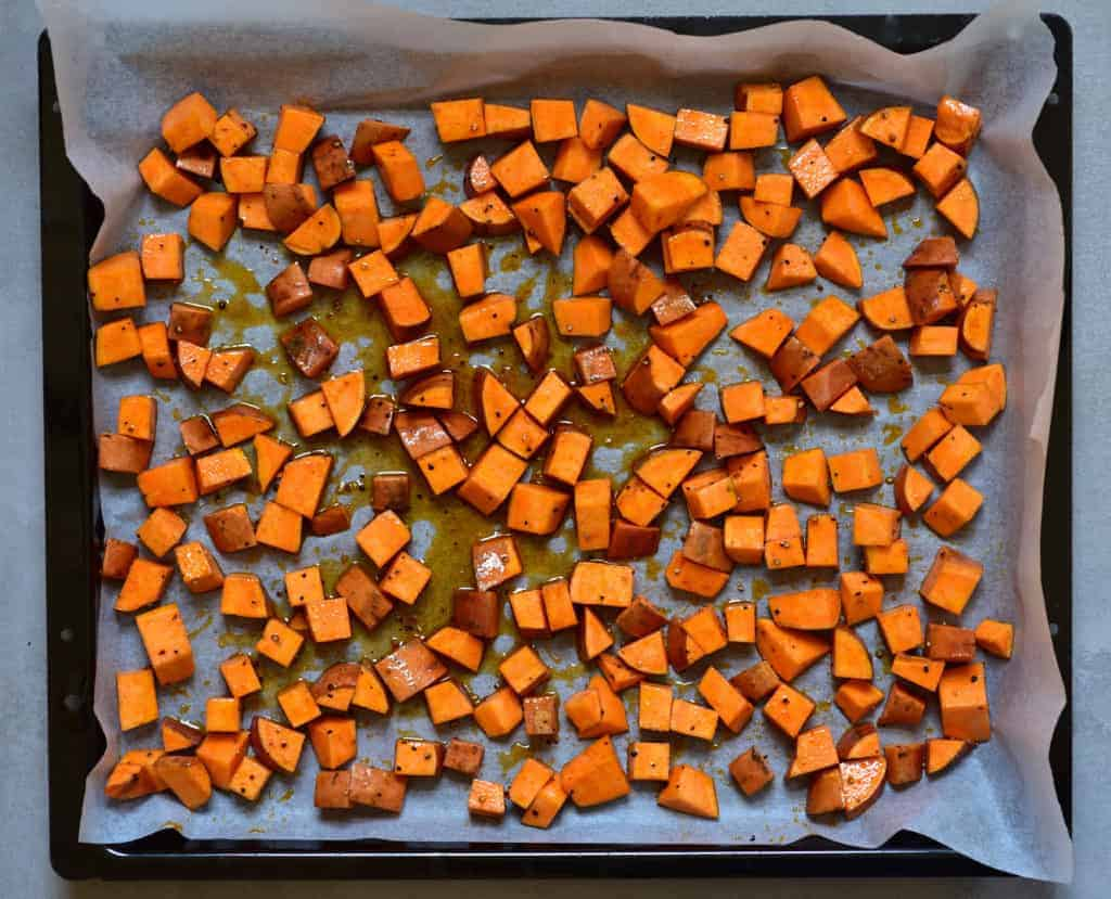 Chopped sweet potato on a baking tray