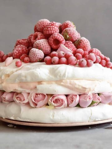 Eton mess meringue pavlova cake with berries and coconut cream