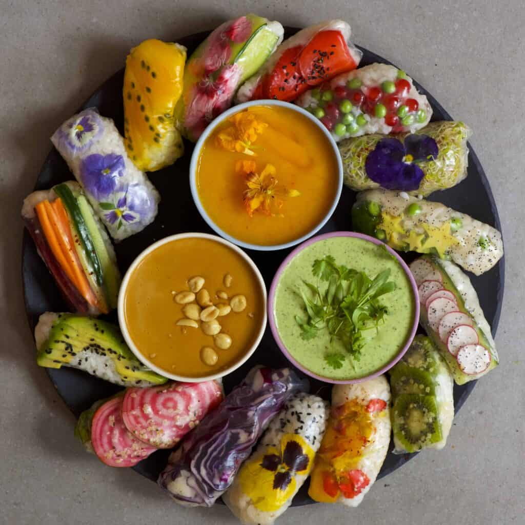 vegan rainbow rice paper rolls with fruits vegetables mango sticky rice and noodles