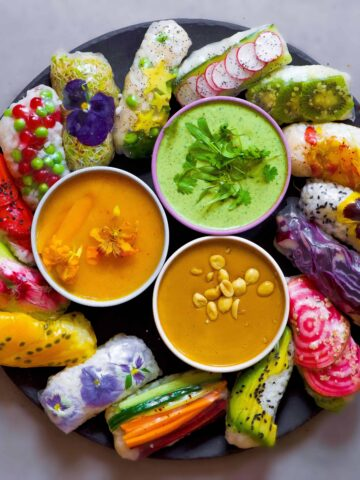 delicious vegan rice paper rolls with mixed vegetables and fruit an three dipping sauces