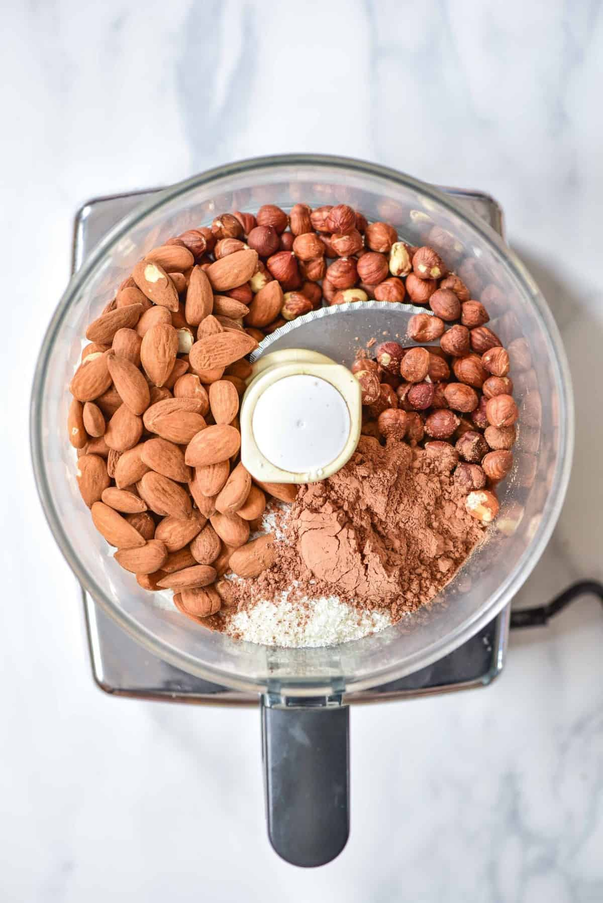 Nuts and cacao powder in a blender