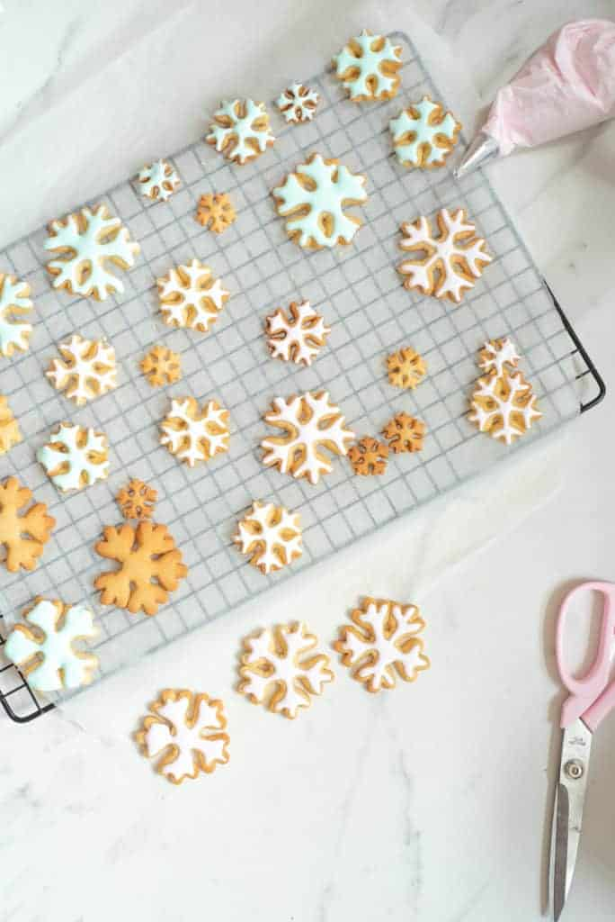 delicious decorated Christmas sugar cookie recipe. Orange sugar cookies made in fawn, snowflakes and tree shaped cookies. a yummy Christmas biscuits recipe
