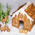 Gingerbread house with gingerbread characters in fruit of it