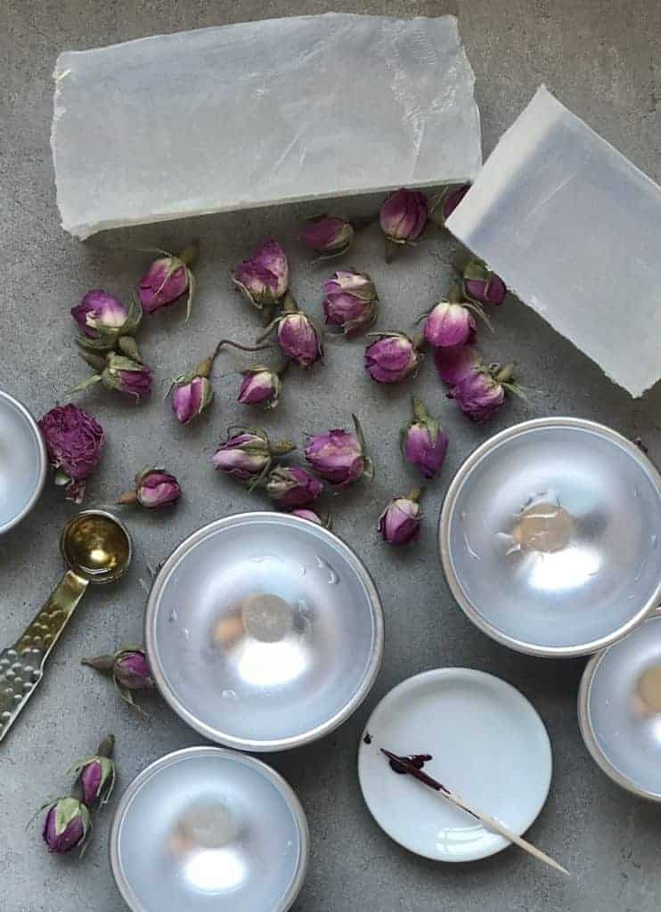 A simple DIY for how to make soap at home with various soap making ingredients and additives, using a melt & pour base recipe. Plus a rose-infused soap spheres recipe.