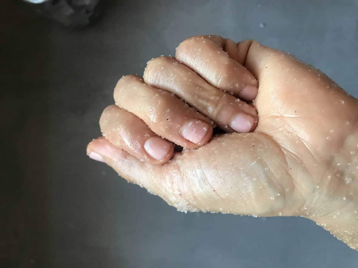 DIY coconut oil sugar scrub recipe a homemade body scrub. This blog also includes how to make sugar scrub, what is sugar scrub used for and how long will sugar scrub last.