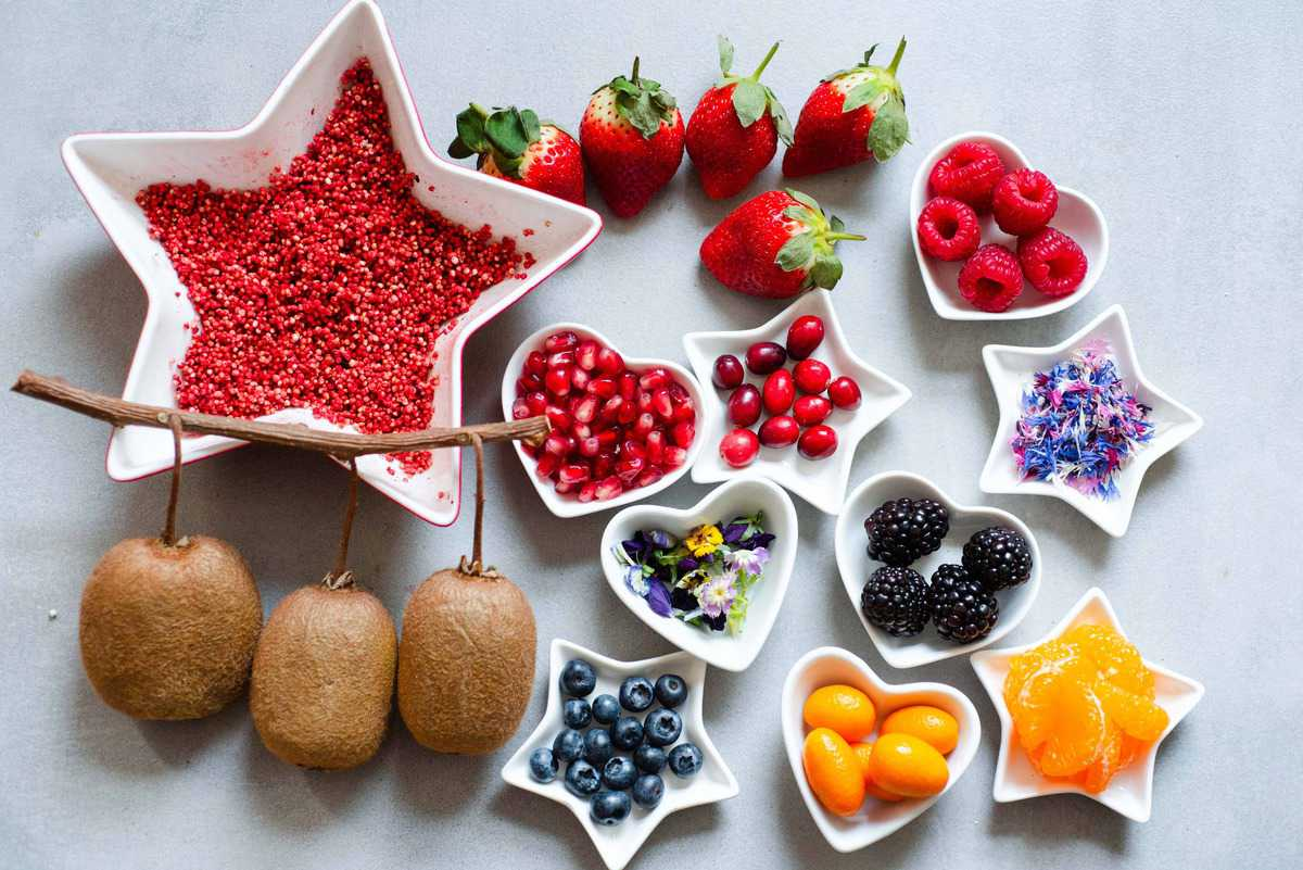delicious festive fruit selection including cranberries, pomegranate, puffed quinooa, clementine, blueberries etc.
