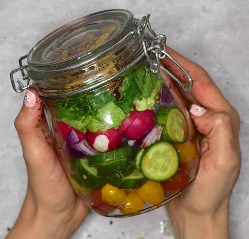Lebanese fattoush salad in a jar recipe with vegetables, pomegranate and toasted pita. Quick salad jar