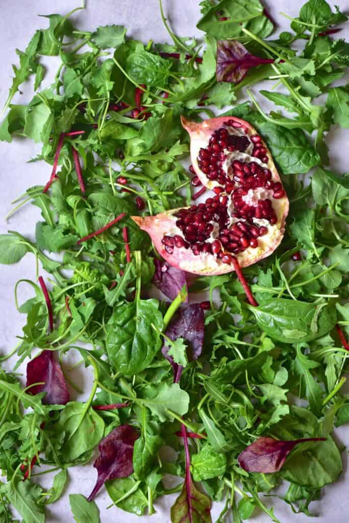 Green salad leaves and pomegranate