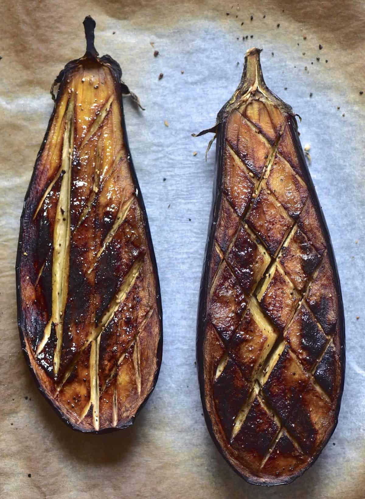 Two baked halves of an eggplant