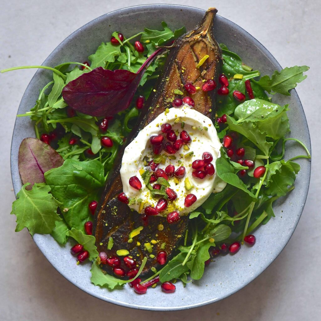 Aubergine eggplant salad with yogurt and pomegranate seeds