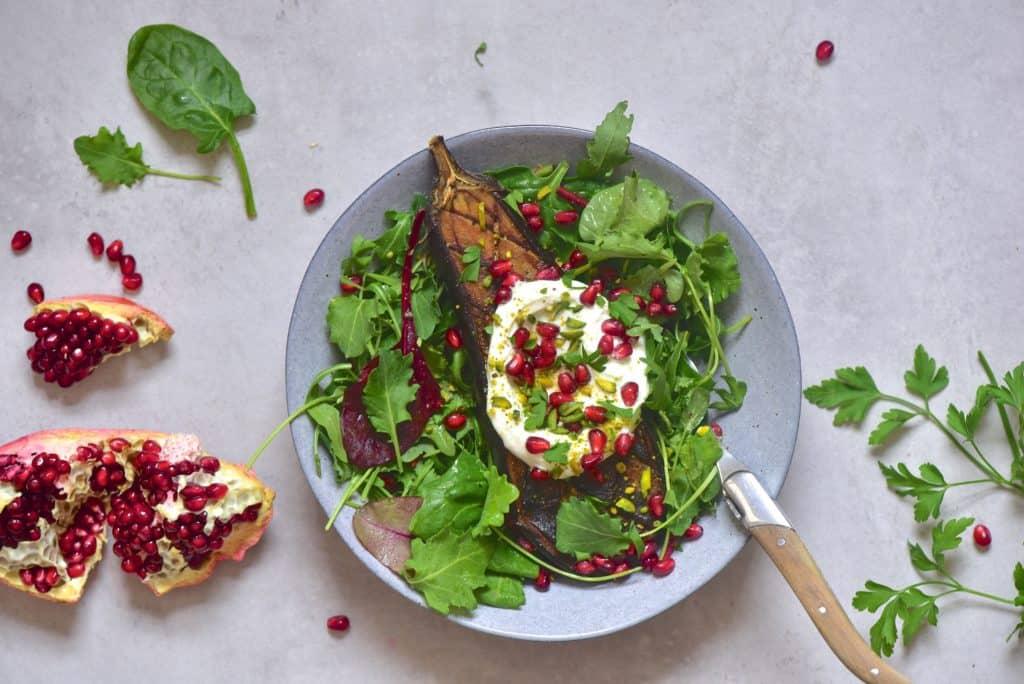 Aubergine eggplant salad with yogurt and pomegranate seeds