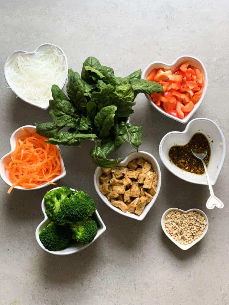 Noodles, broccoli , carrot, peppers, spinach, tofu, Thai salad dressing and peanuts