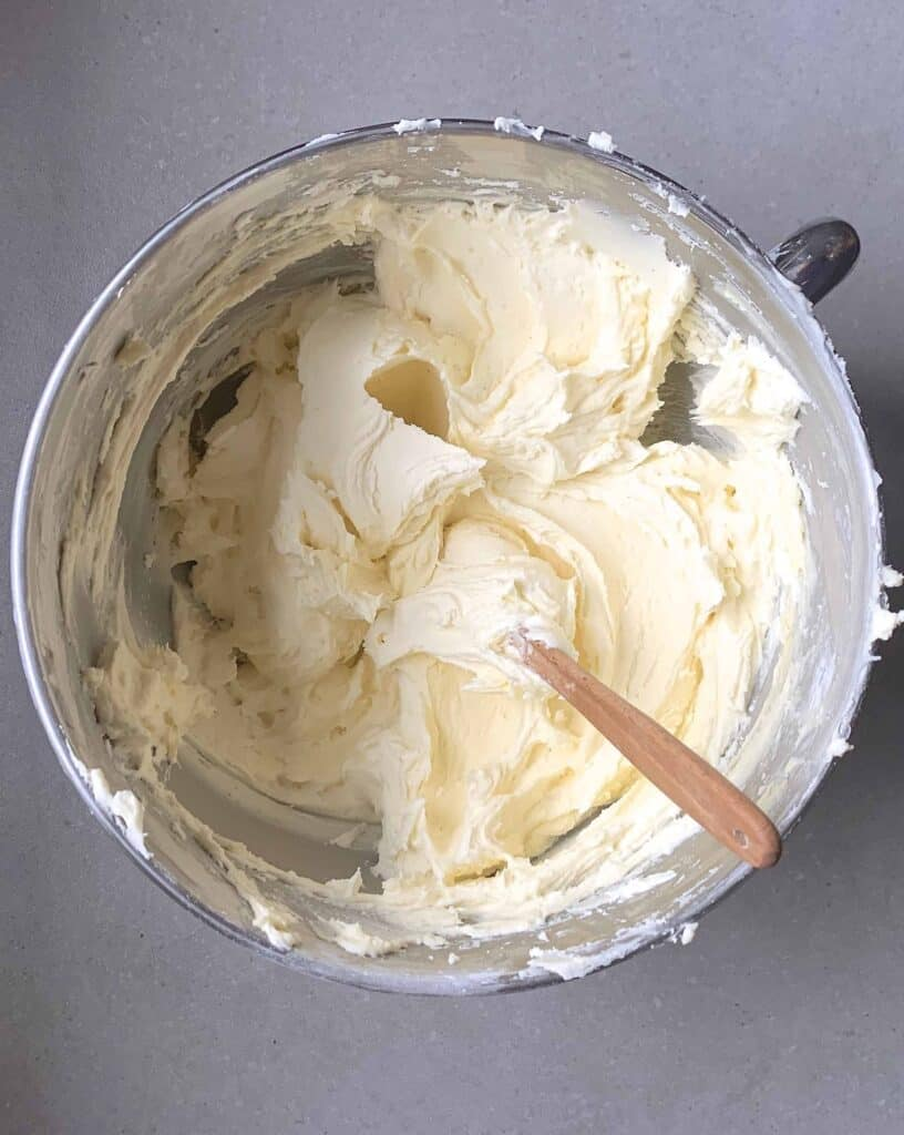 Butter frosting in a large bowl
