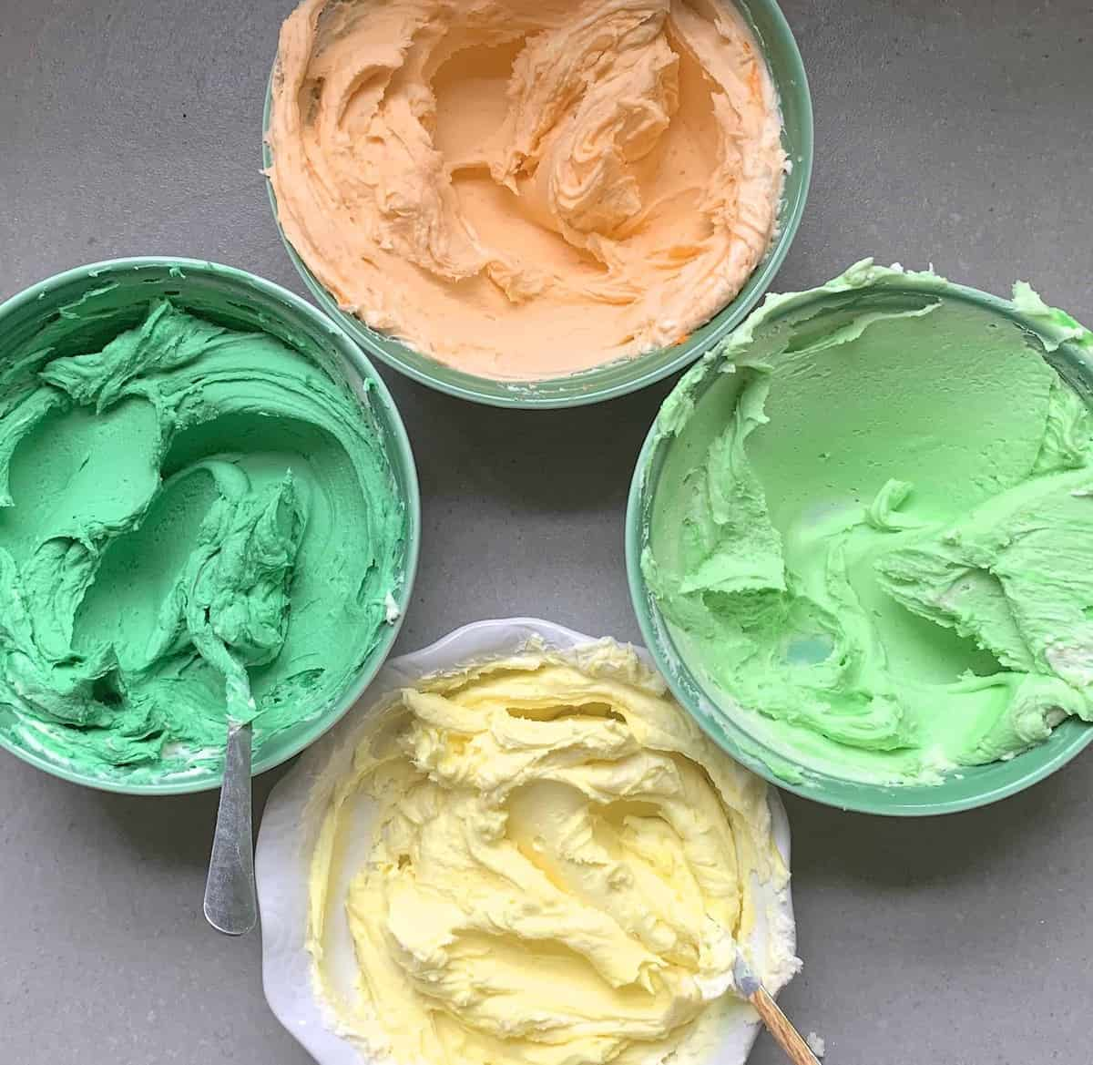 buttercream with different colors in different bowl