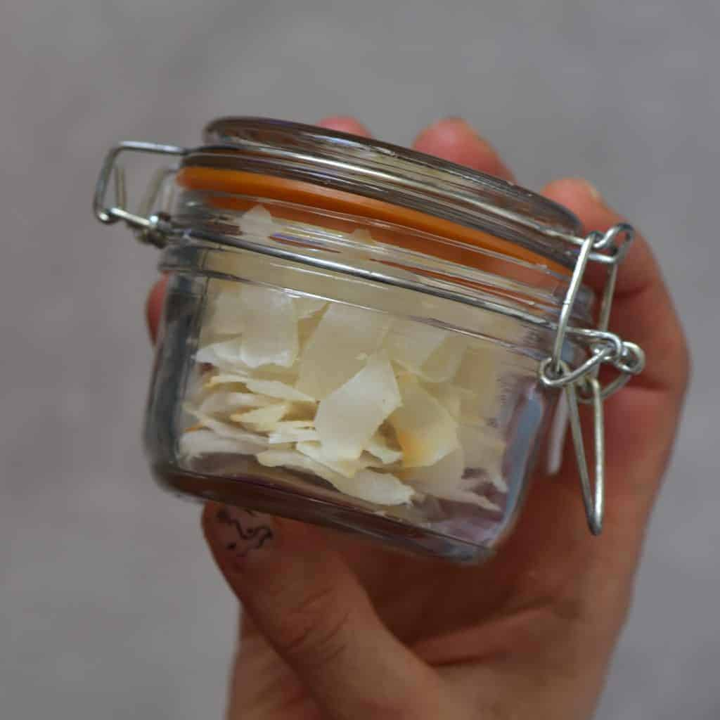 homemade coconut chips in a glass jar ( coconut flakes)