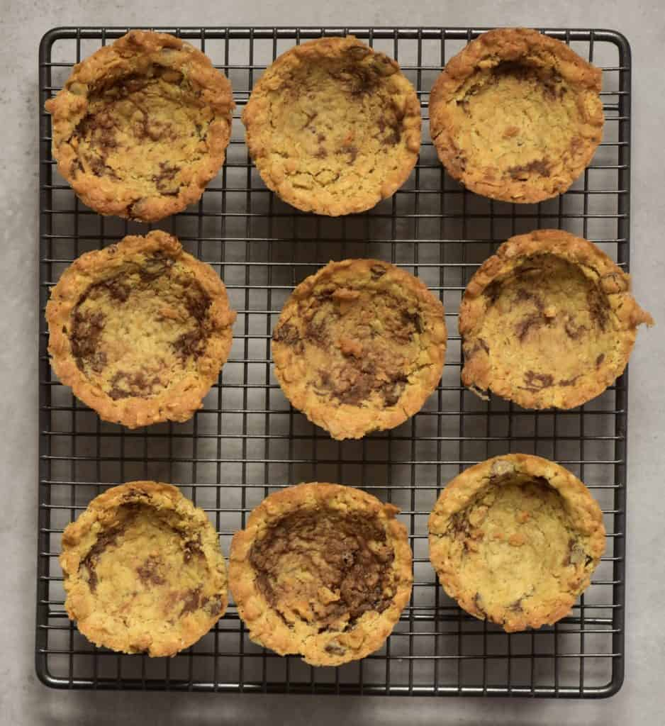Cookie cups arranged on a cooling rack
