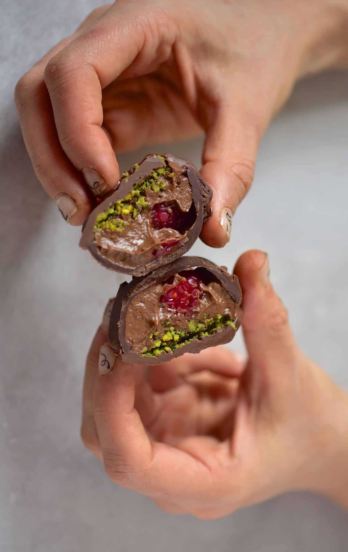 heart-shaped chocolate truffles with avocado chocolate mousse, raspberries and pistachios