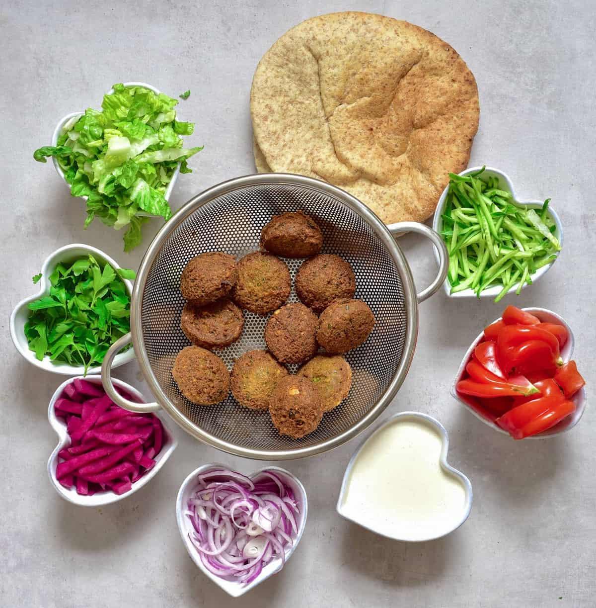 vegan easy falafel wrap with homemade tahini dressing and salad