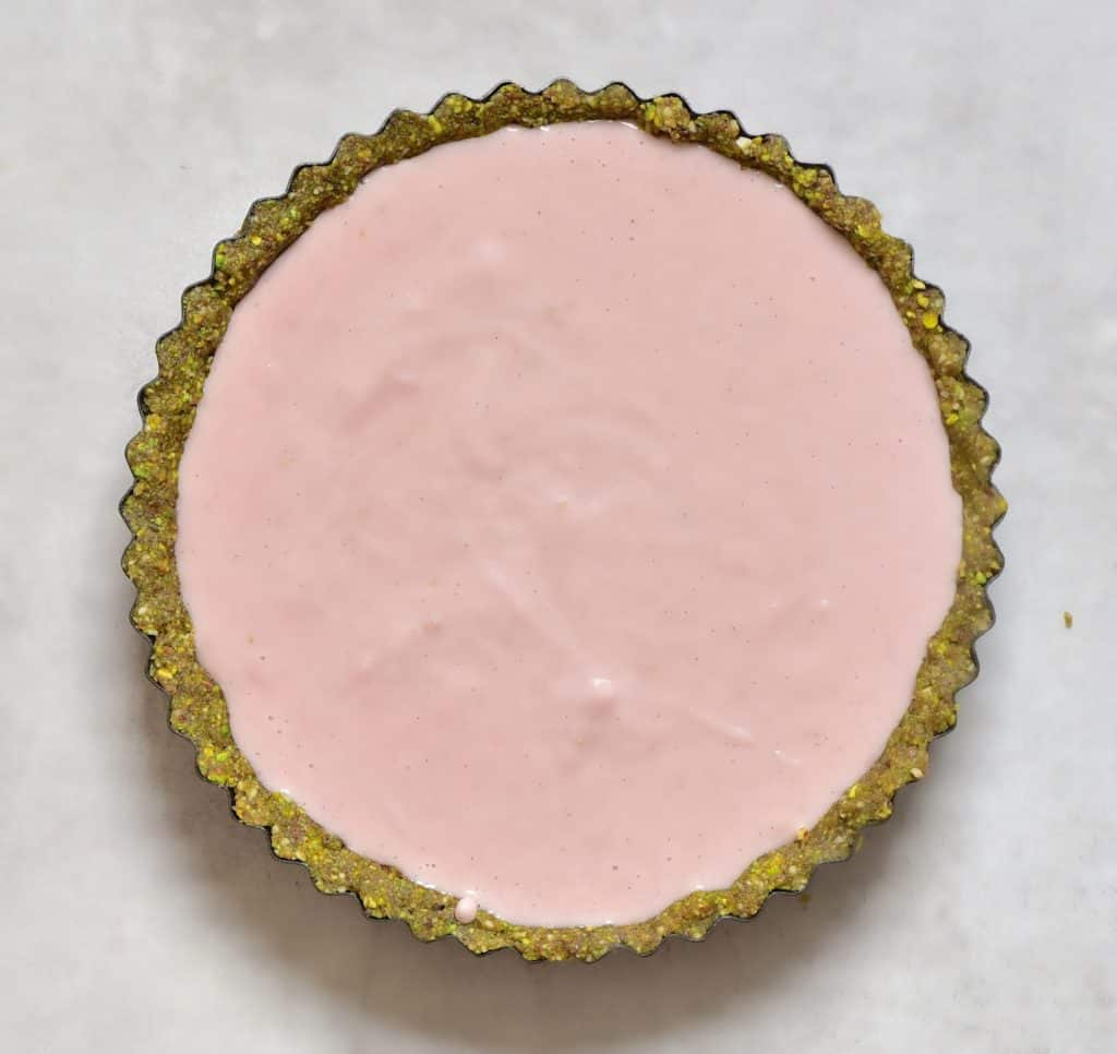 Vegan Pistachio, Strawberry & Rose Tart before being decorated