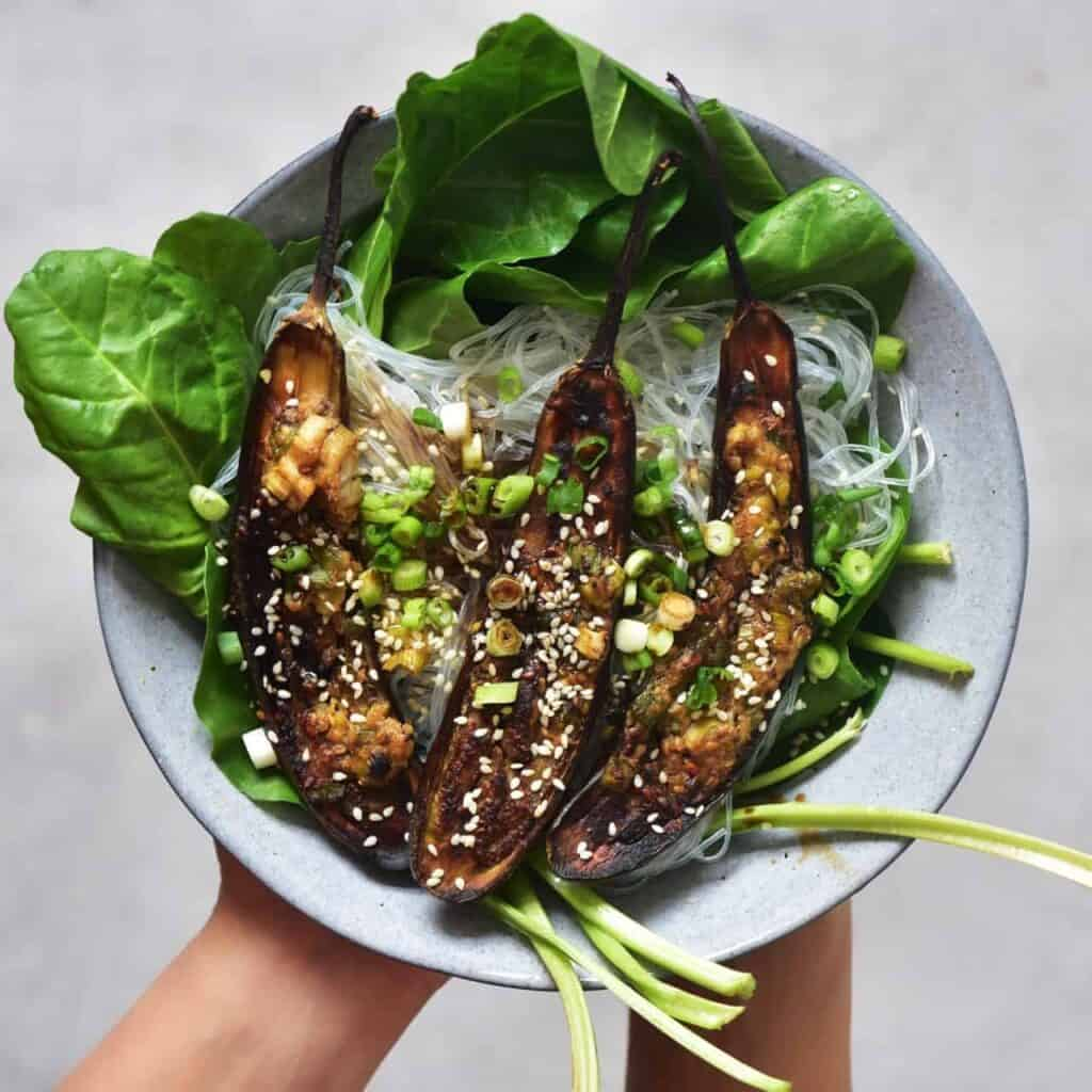 Miso-glazed aubergines with salad and glass noodles