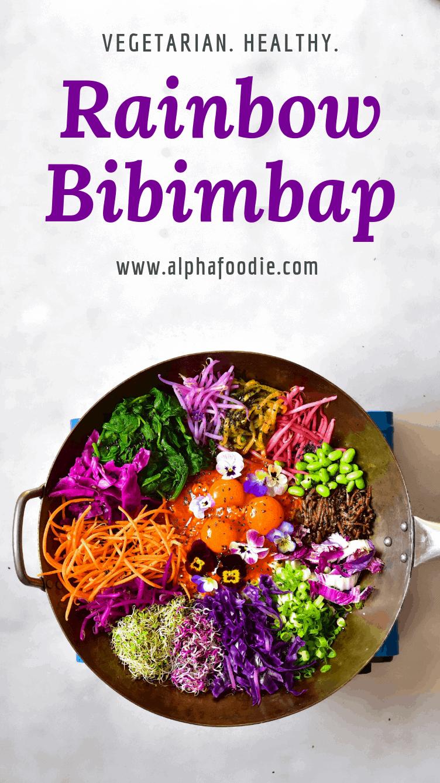 Rainbow veggies and egg yolks on top of rice for a homemade rainbow vegetarian bibimbap