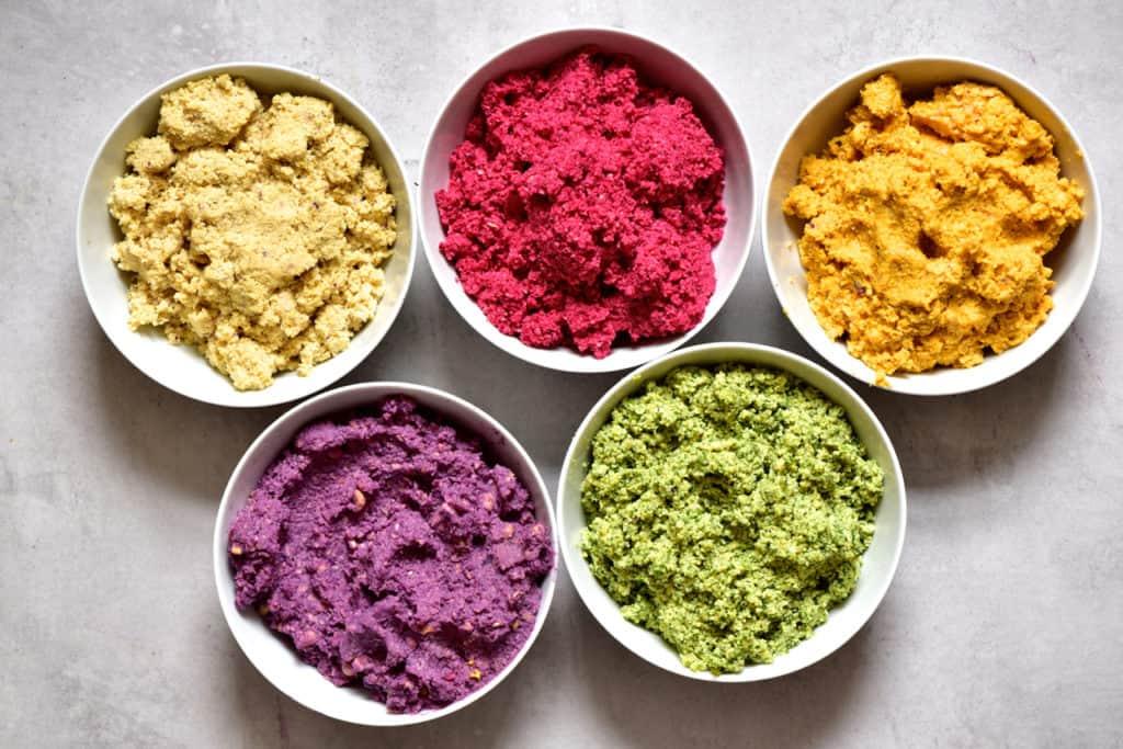 Falafel paste in 5 rainbow colours for vegan falafels as part of a mezze platter