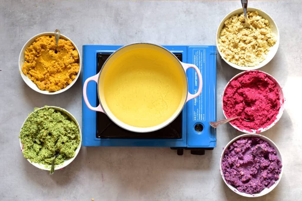 Falafel paste in 5 rainbow colours ready to be fried for a mezze platter