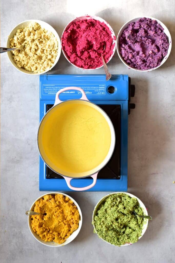 Falafel paste in 5 rainbow colours ready to be fried