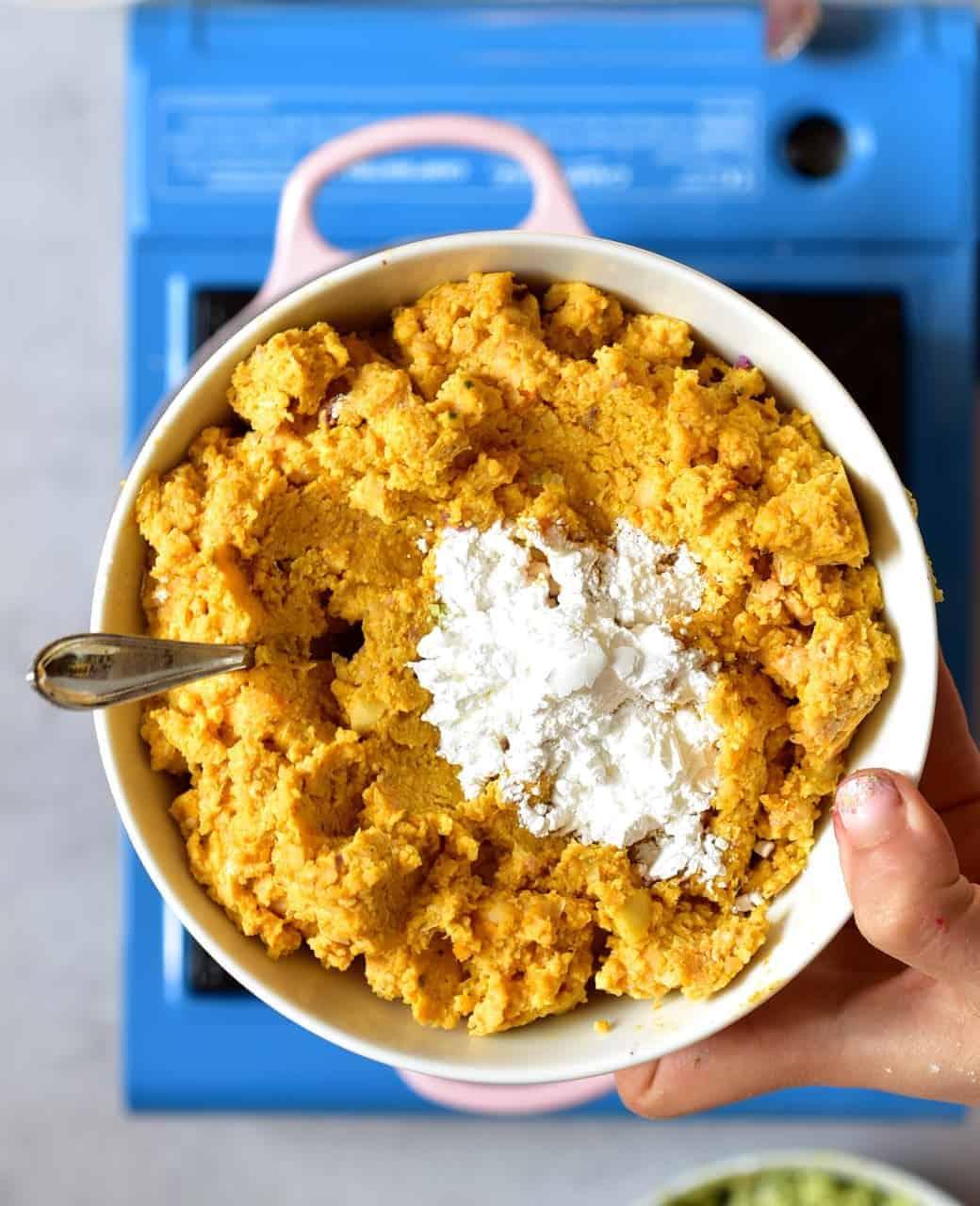 Orange falafel paste with baking powder, ready to be fried