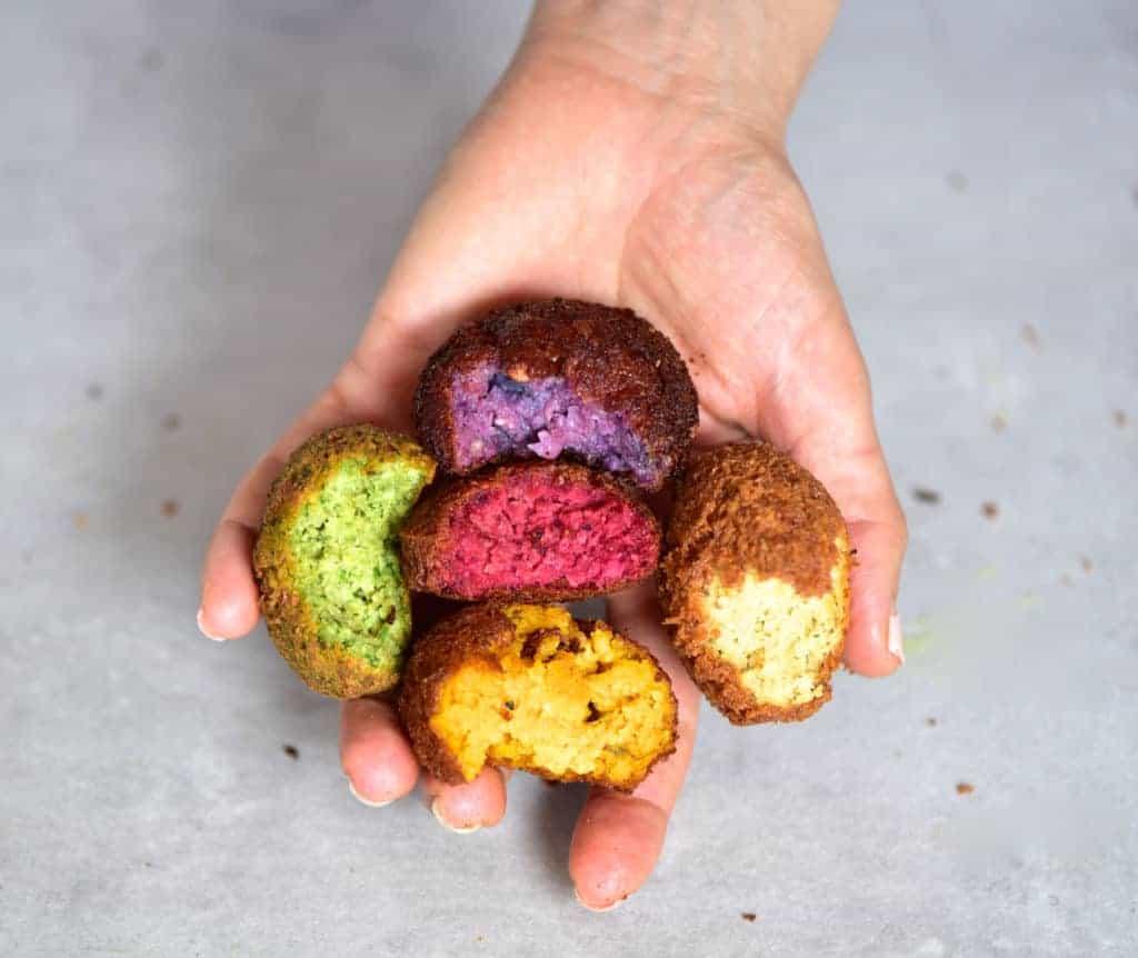 Rainbow vegan falafels as part of a mezze platter