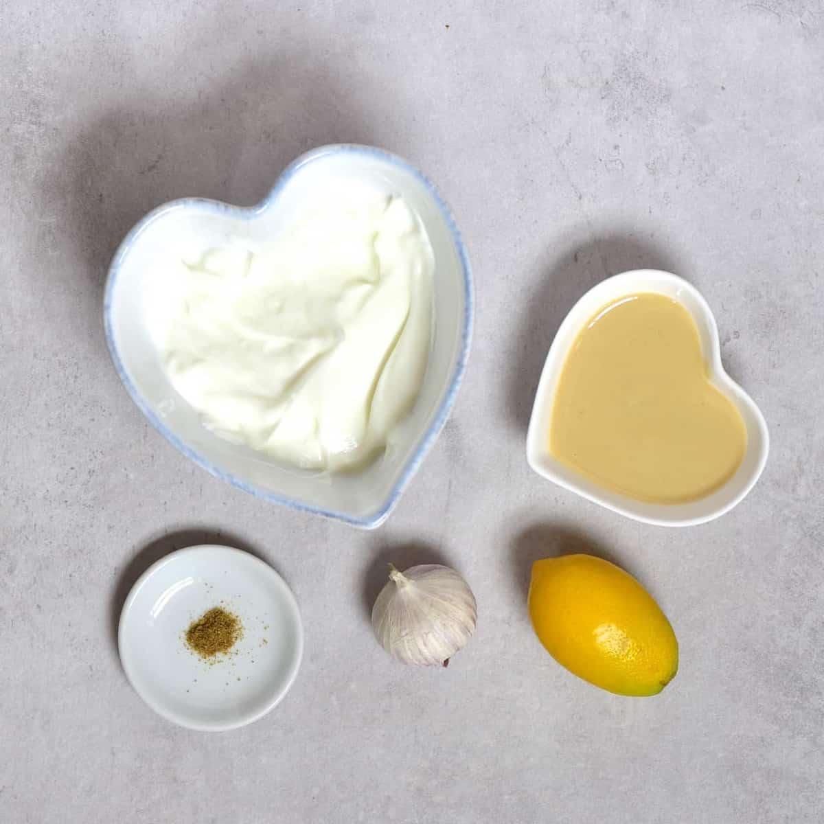 Ingredients for homemade yogurt vegan tahini dip