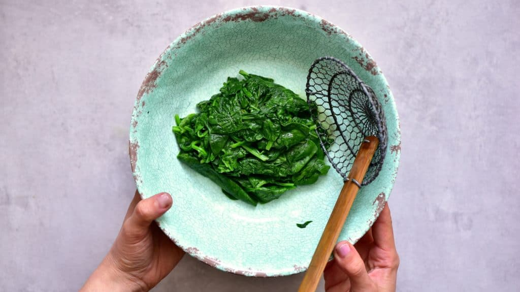 Wilted fresh baby spinach