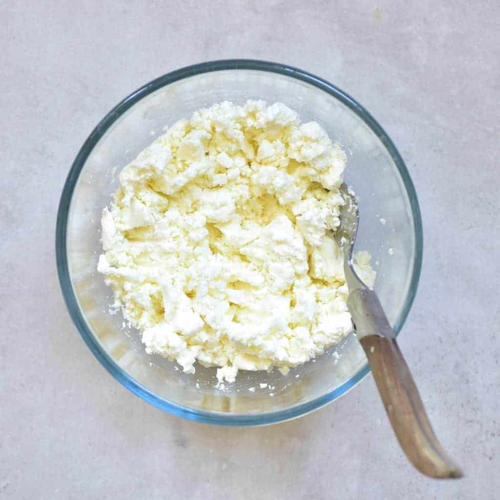 Goat cheese mashed in a bowl
