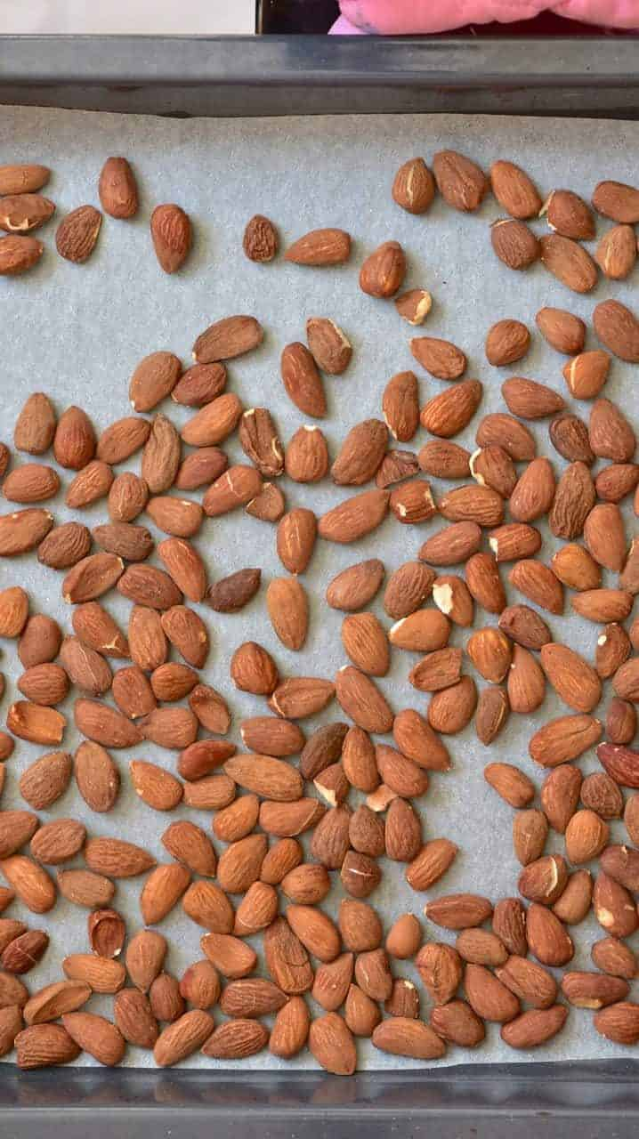 raw almonds on a baking tray